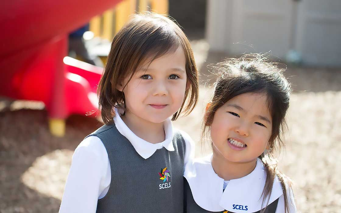 two-girls-in-kindergarten-playground.jpg